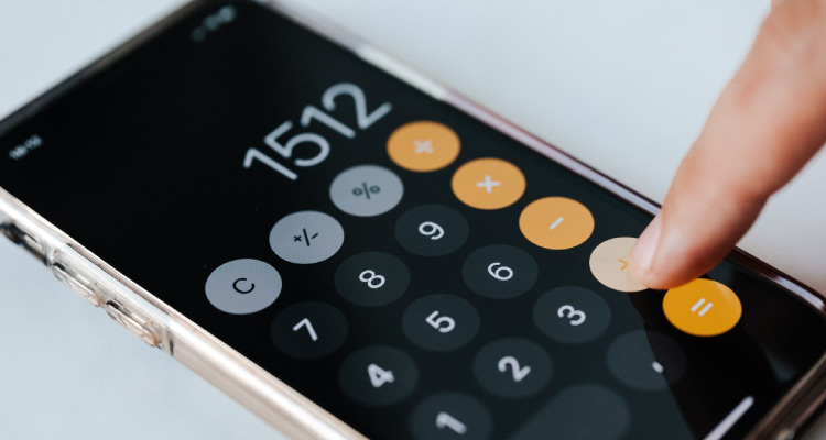 understanding profit margins, calculator being used